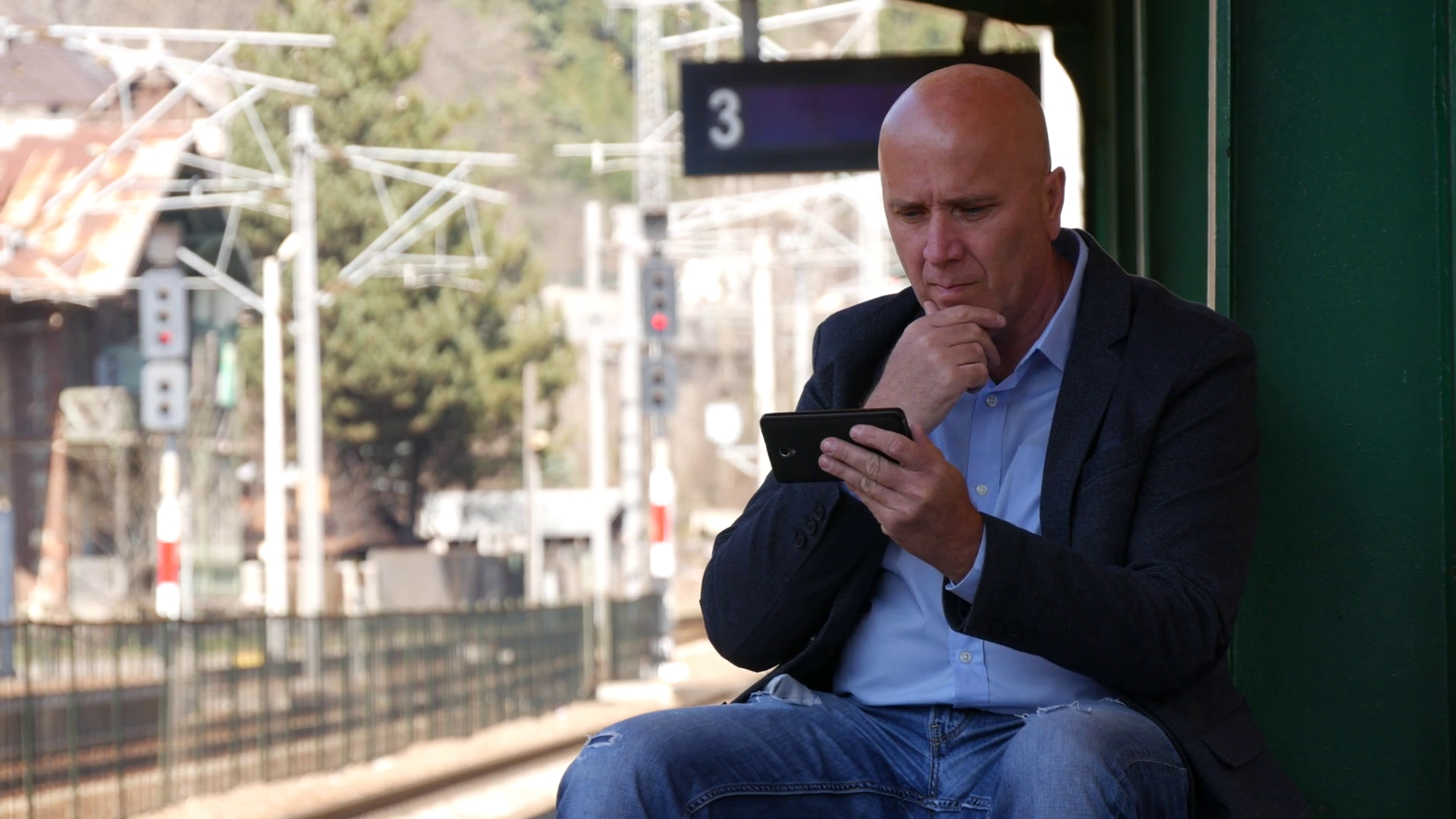 Person Sitting And Playing With Phone