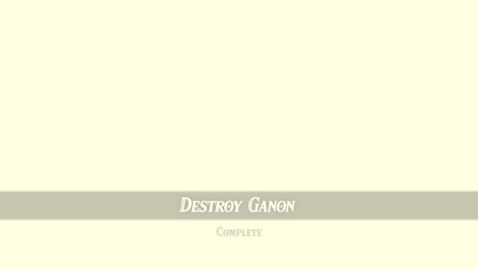 Screenshot from Zelda: Breath of The Wild. A white screen with the text at the bottom that says 'Defeat Ganon, Quest Complete'.