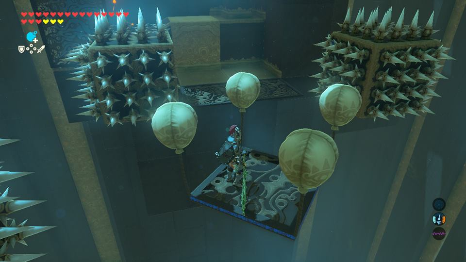 Screenshot from Zelda: Breath of The Wild. Link is on a platform that is floating in the center. It has four yellow balloons attached to the platform. It is headed between to blocks that have spikes on all sides.