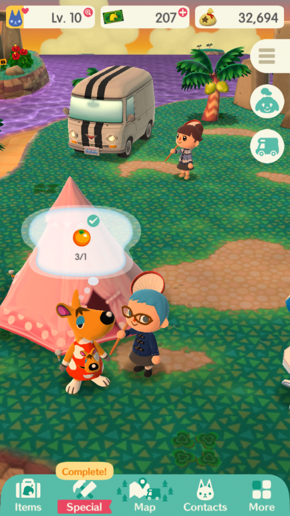 Screenshot from Animal Crossing Pocket Camp. Green terrain with a pink tent and camper in the background. A kangaroo and a female with blue hair and a blue coat is speaking to the kangaroo.