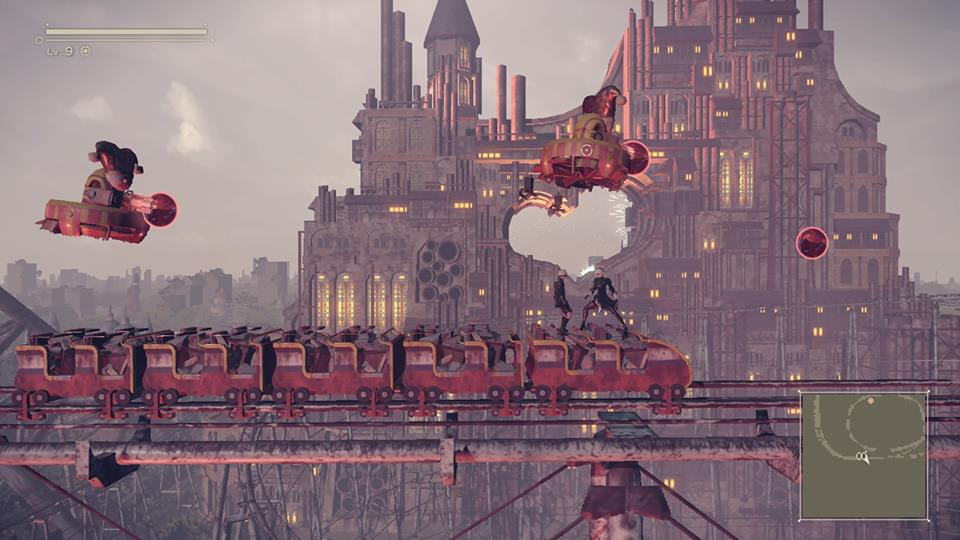 Screenshot from Nier Automata. 2B and 9S standing on top of a roller coaster. They are fighting two robots that are flying above them in clown garb.