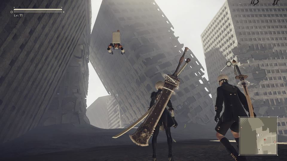 Screenshot from Nier Automata. 9S is facing the ruins of several tall buildings.